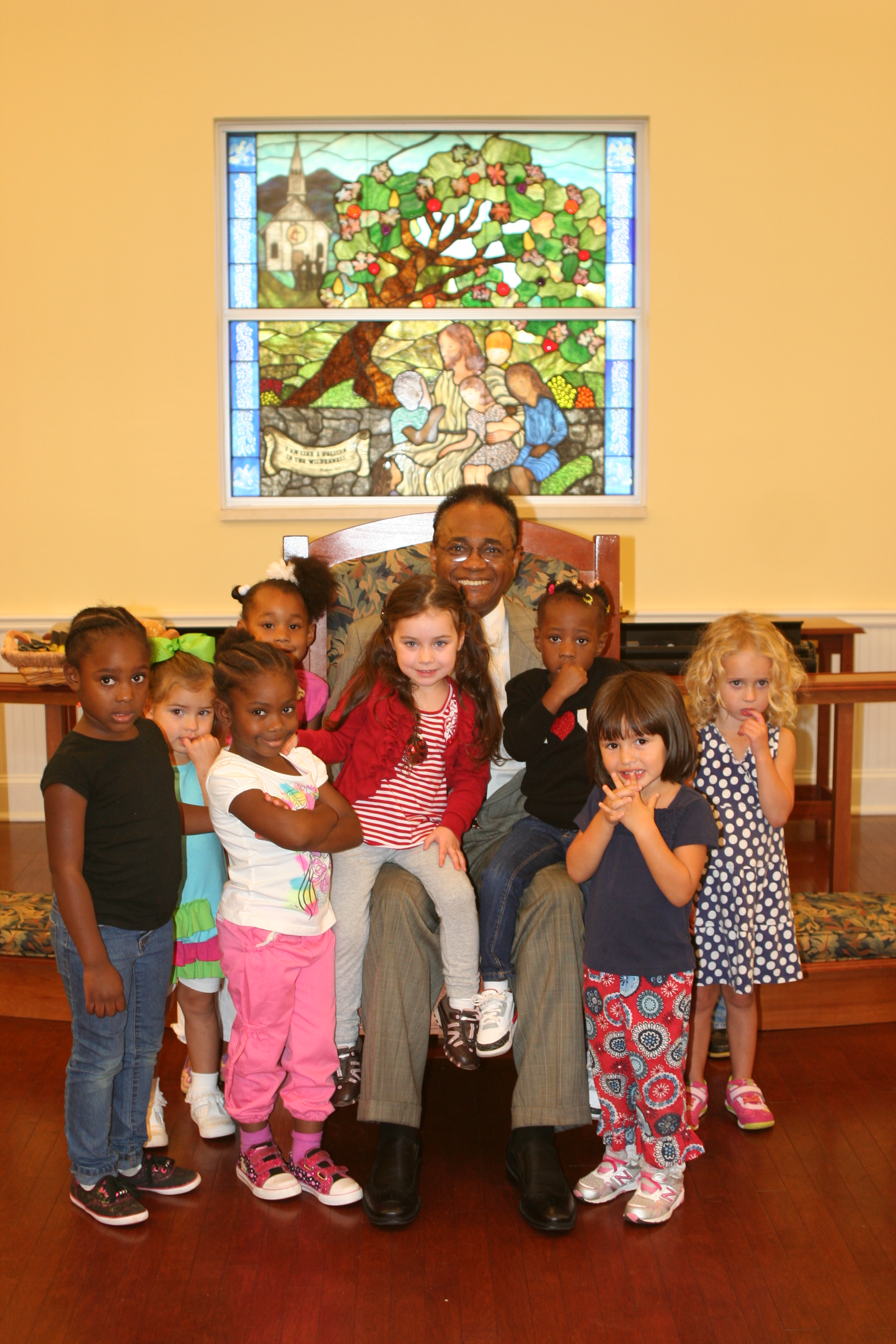 Bishop King and the little ones attending chapel at the MCH.