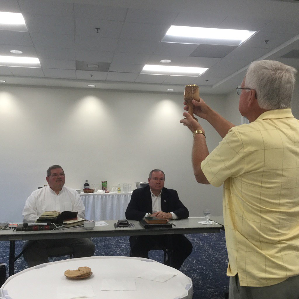 Wayne Moseley leads Holy Communion during retreat